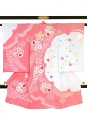 ピンク地に疋田の花文様と雪輪の祝い着/女児